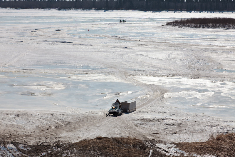 Snowmobile traffic on the Moose River 2011 April 15th.