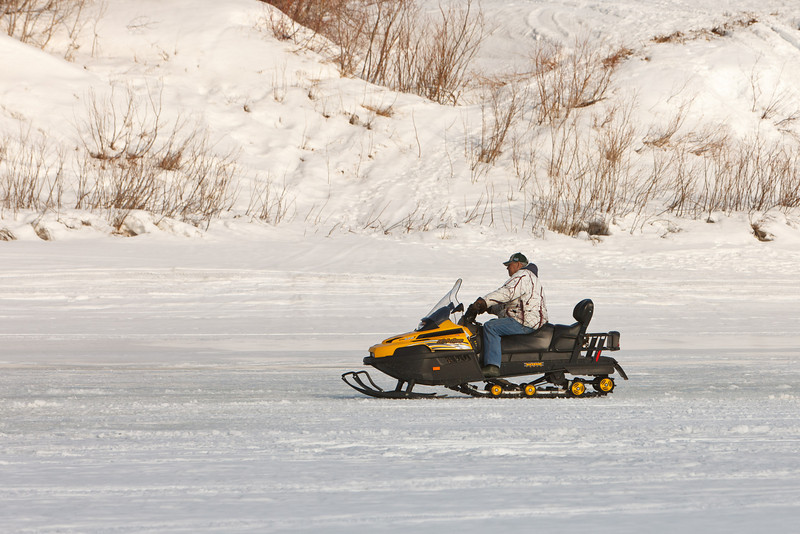 Leo Etherington on snowmobile on the Moose River.