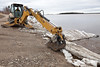 Charles (Chuggy) Gagnon from Town of Moosonee removing ice from public docks area.
