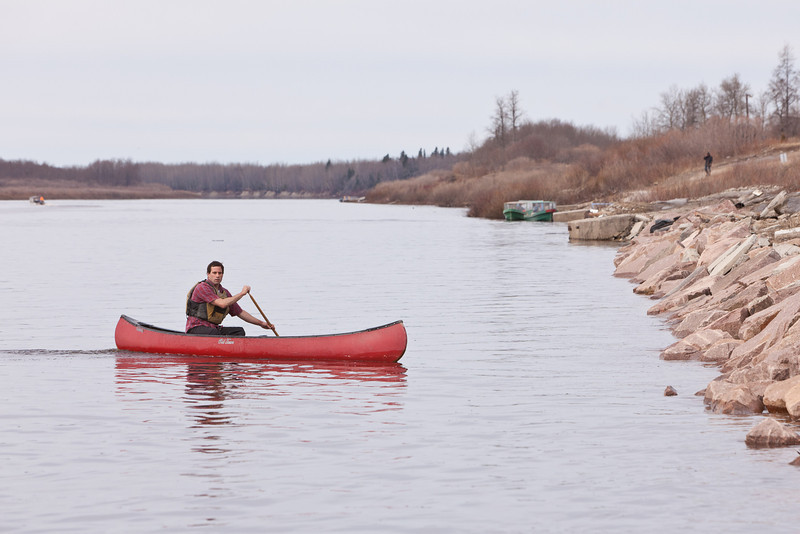 Keewaytinok Native Legal Services articling student Brian D. O'Neill comes to work via a short canoe trip on the Moose River at Moosonee, Ontario 2011 May 10th.