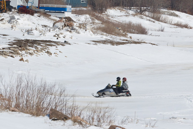 Snowmobile on the Moose River near barge docks 2011 April 19th