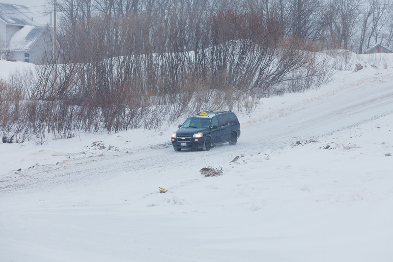 Taxi coming down McCauley's Hill