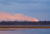 Looking towards Moose Factory from Moosonee early morning 2011 October 13th, flames and smoke visible.