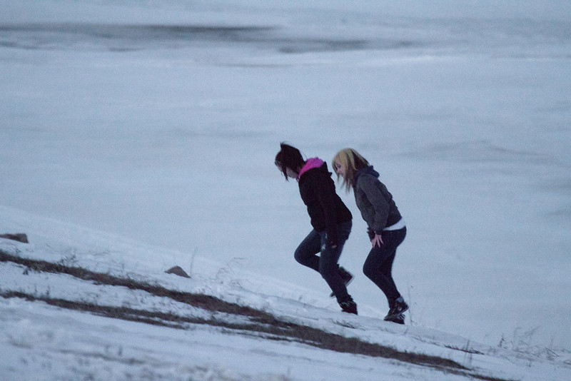Two people come up the river bank in Moosonee 2011 April 19th