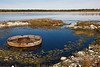 Sewage lagoon metal structure.