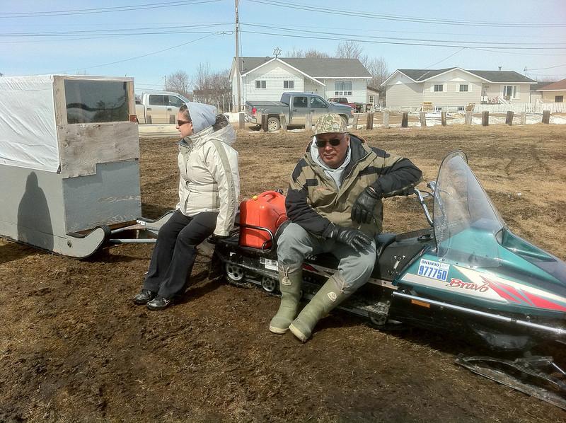 Robert Blueboy, snowmobile taxi operator on McCauley's Hill 2011 April 21