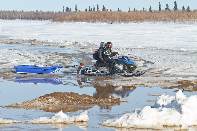 Traffic on the start of the road to Moose Factory seen from McCauley's Hill in Moosonee 2011 April 1st.