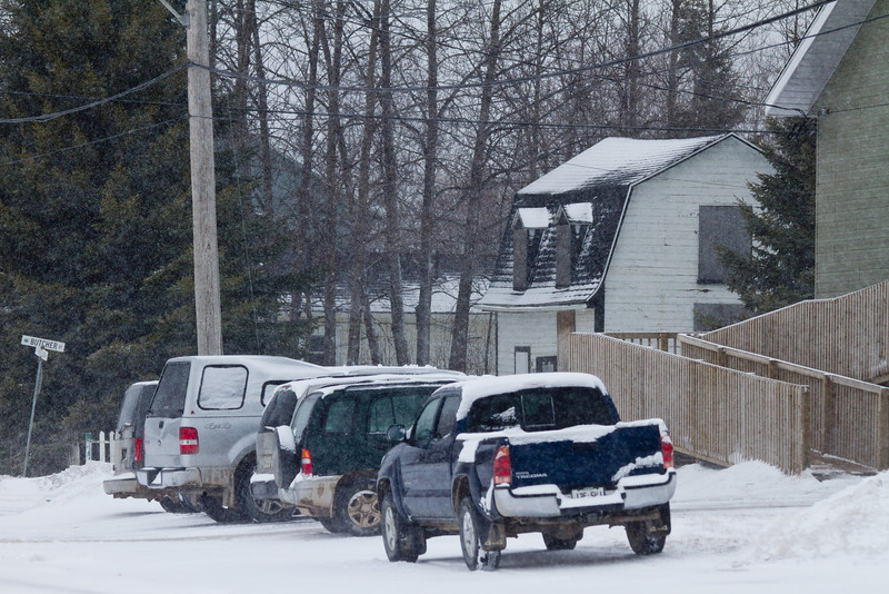 Vehicles parked for church.