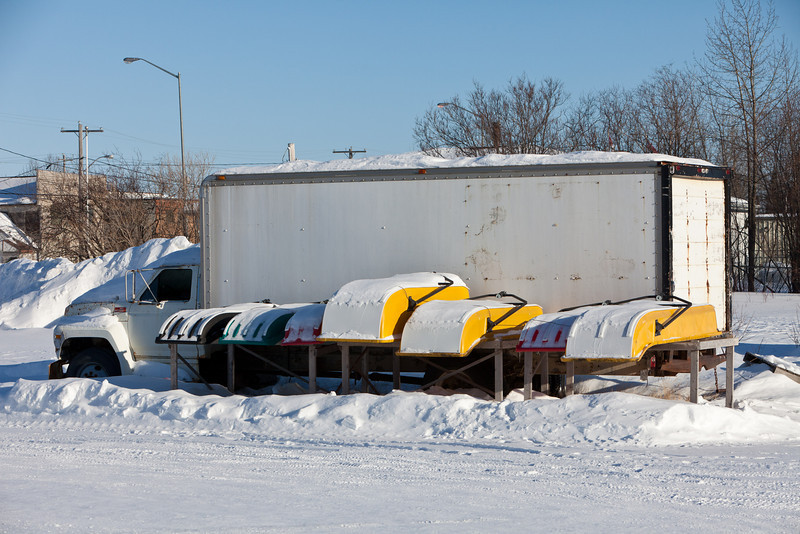 Snowmobile sleds for sale in downtown Moosonee.