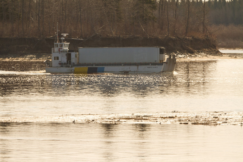 Barge Manitou Island II heading to Moose Factory from Moosonee 2011 May 15th. Seen here in front of Butler Island, this barge is scheduled to be replaced by the new barge Niska I.