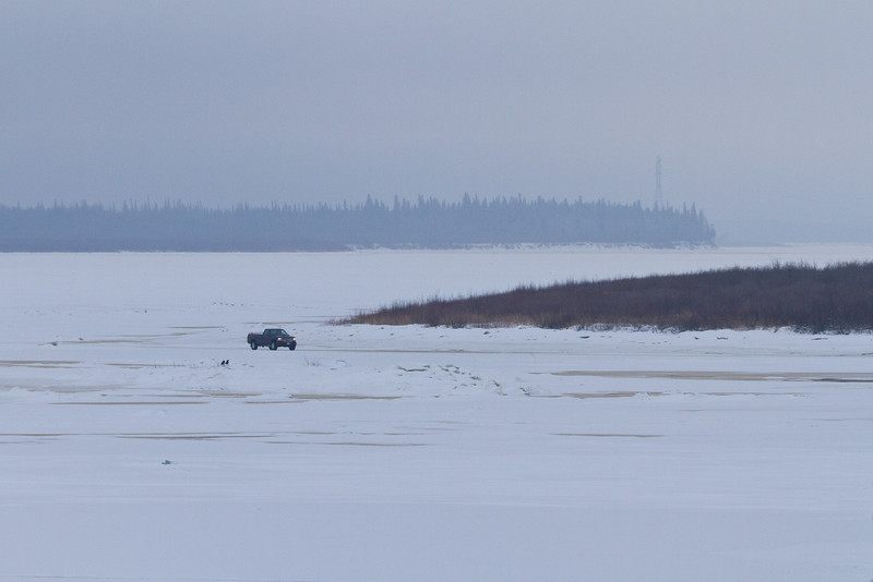 Truck approaching Moosonee on the winter road from Moose Factory.