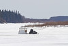 Snowmobile and sled on the Moose River 2011 April 21