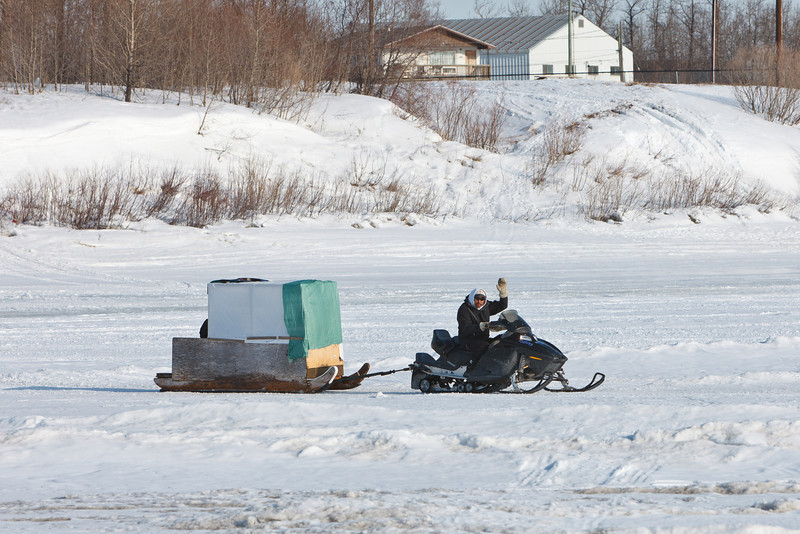 Snowmobile taxi on the Moose River.
