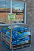 Water damaged bird seed is on sale for $10 a bag.