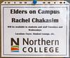 Northern College Cultural Program in Moosonee. Rachel Chakasim, elder on campus sign.