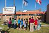 Northern College Cultural Program in Moosonee. Dorothy Wynne showing exhibits to school children from Bishop Belleau.