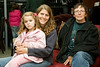 Emma Lavers (aged 5, Karen Passarello and Michelle try out a chaise lounge at the opening of the Brick in Moosonee