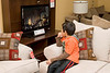 Seven year old Jeremiah Nakogee enjoys watching a flat screen TV