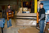 Tyson and Mervin Iserhoff assembling furniture in the warehouse