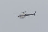 Helicopter C-FODI in the rain over the Moose River 2017 May 29th.