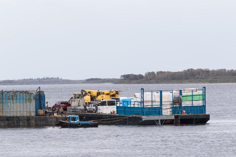 Small tug moving barge in Moosonee.