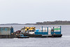 Small tug moving barge in Moosonee.