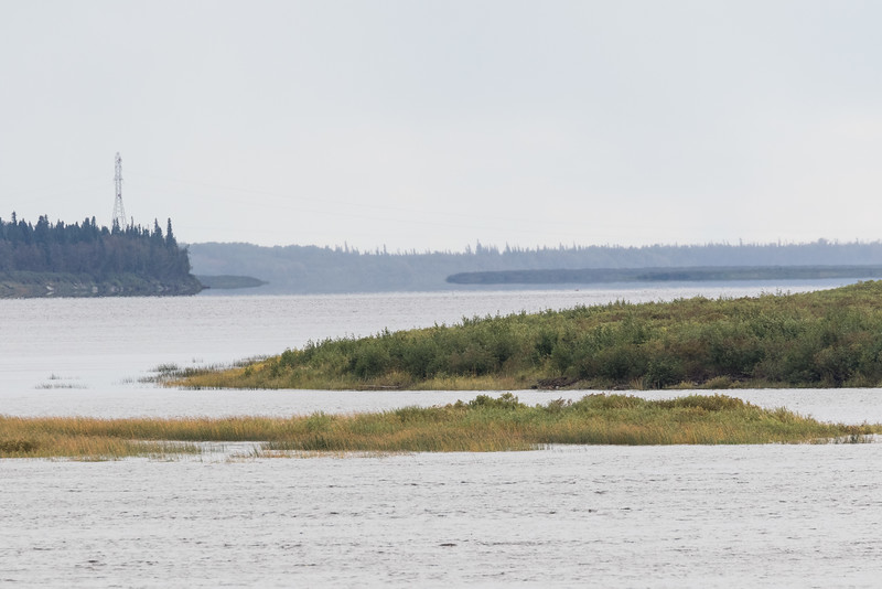 Looking up the Moose River from Moosonee as light rain moves further up the river.