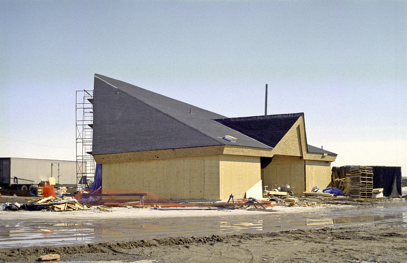 Roll 131: Moosonee airport terminal under construction. View from road. Scanned from film.