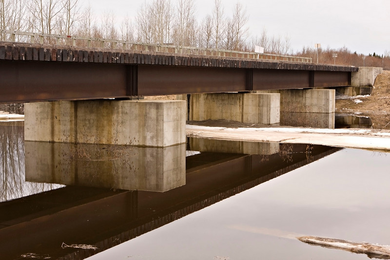 Store Creek rail bridge during spring breakup, note how concrete portions of bridge are partially submerged