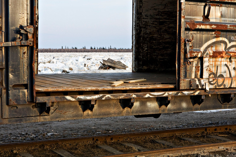 Boxcar on siding on Revillon Road North in Moosonee beside the Moose River