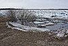 Limit of water shown by thin sheet of ice on shore near Moosonee Pentecostal Church