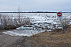Road leading to public docks in Moosonee, thin ice shows limit of water