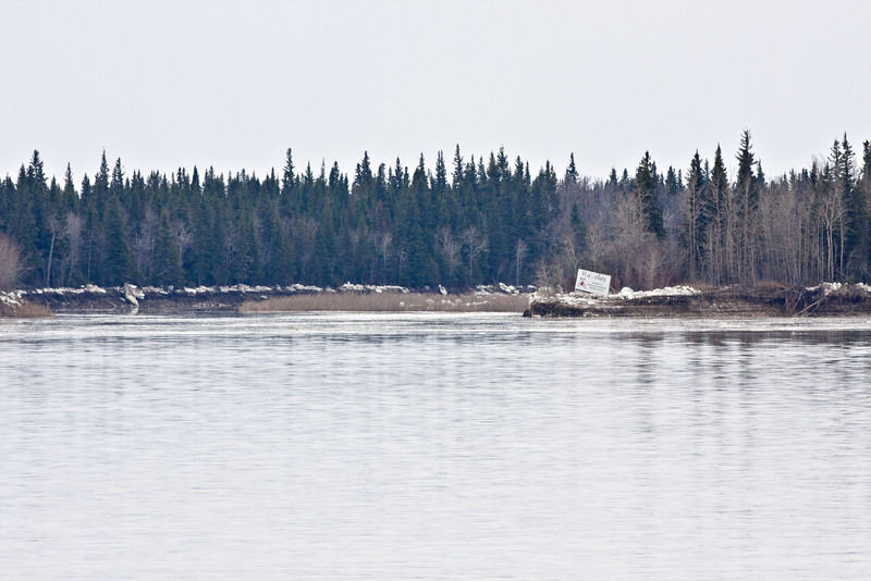 The Gutway, water level has gone down a lot, the Moose Cree Territorial sign is well above the water now.