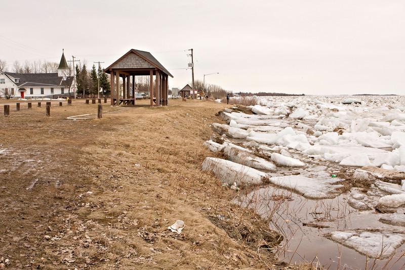Ice along the shoreline looking downriver in Moosonee