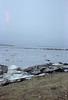 Ice piled along the shoreline.