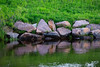 Granite rocks along the edge of the Moose River.