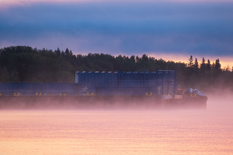 Barge sterns at Moosonee before sunrise.