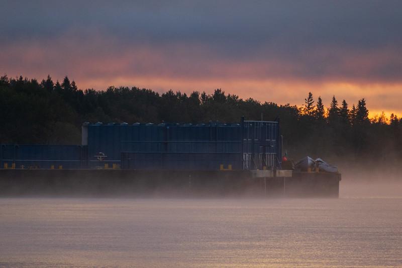 Barge sterns at Moosonee before sunrise.