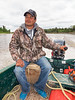 Shane Enosse of Moosonee driving his taxi boat back to Moosonee from Moose Factory.