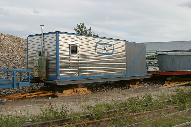 Tractor train accommodation sled or caboose in storage. 2004 July 23rd.