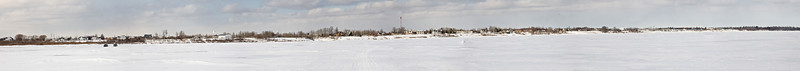 Composite image panoramic view of Moosonee from the Moose River. 2007 March 11th. 6400 pixels by 568 pixels.