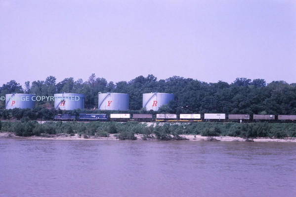Mopac 220 - Aug 1973 - NB train along river south of St Louis MO