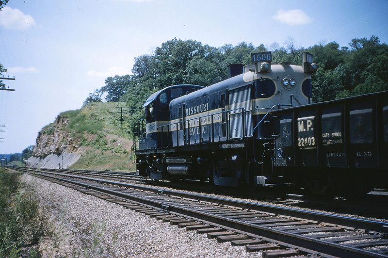 Mopac 114 - Jun 2 1955 - Alco GE raod switcher No  4506 on train 91 Barretts MO