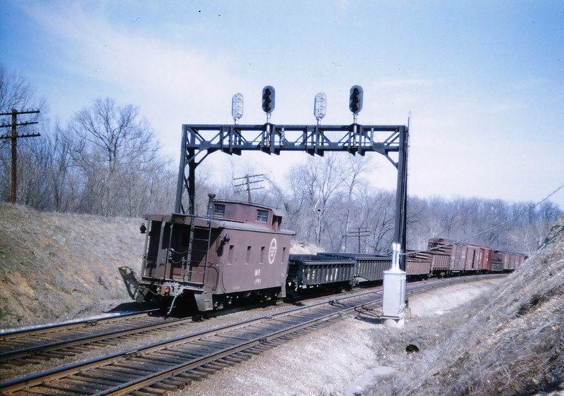 Mopac 161 - Mar 10 1957 - Caboose on EBF @ mp 17 10