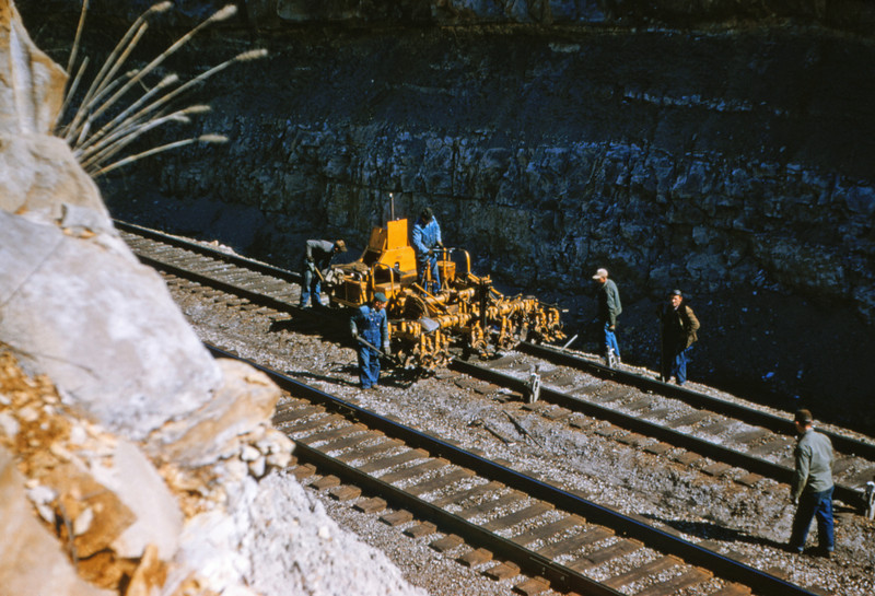 Mopac 95 - Mar 7 1955 - Track ballisting machine in west Barretts Cut MO