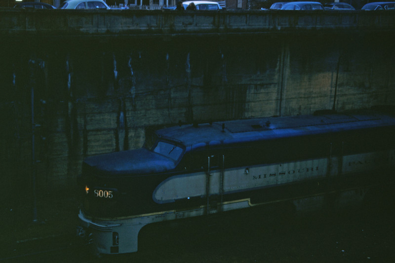 Mopac 165 - Mar 26 1957 - Alco GE unit 8005 on No 21 of Tower Grove Station - MO