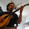 Kevin playing the mandolin.