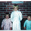 Christmas morning 1959?1960? at #9608 Hilltop Road, Bellevue. Marian, Lora & Jack.