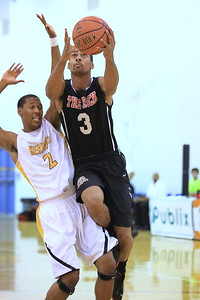 Christian Benzon drives for a layup