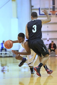 Kobe Eubanks presses past the Rock's Christian Benzon